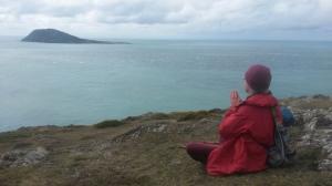 Meditating in sacred landscape near Bardsey Island Wales.