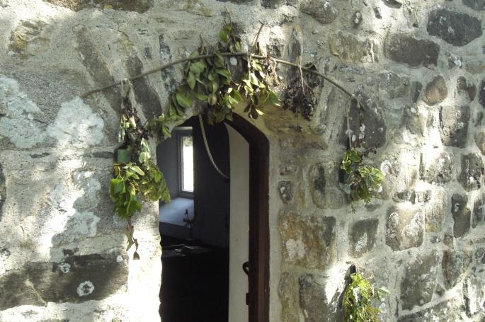 Church door with mistletoe, St. Tudwens, Gwynedd